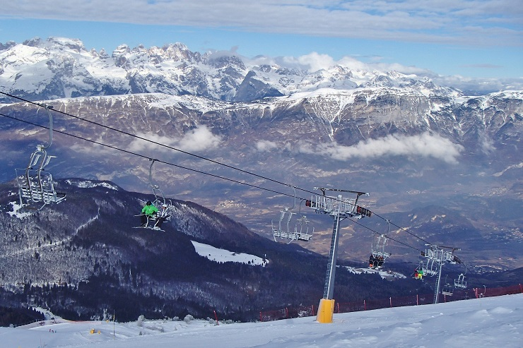 Skiers taking the chairlift to the summit of Monte Bondone ski resort