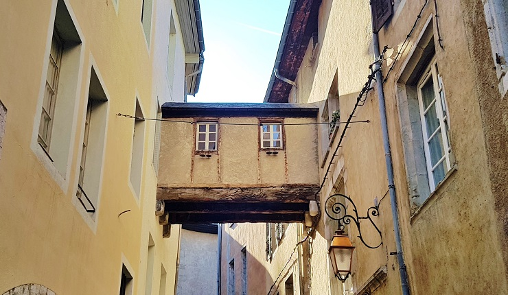 Link between buildings above Chambery's famous alleyways - What to do in Chambery France