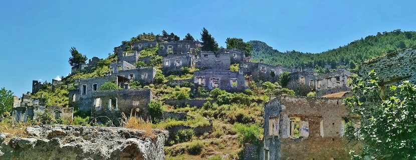 Stone building ruins on the side of a hill in Kayakoy Village