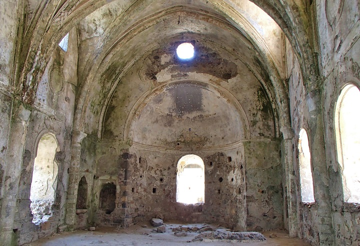 Interior of empty shell of stone church