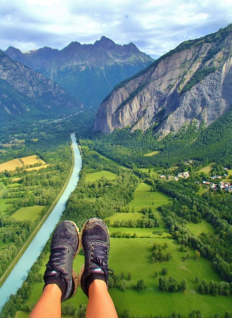 Foot picture while paragliding over the river