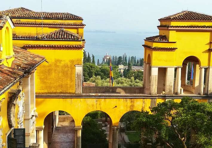 View of Lake Garda through the yellow museum bulding