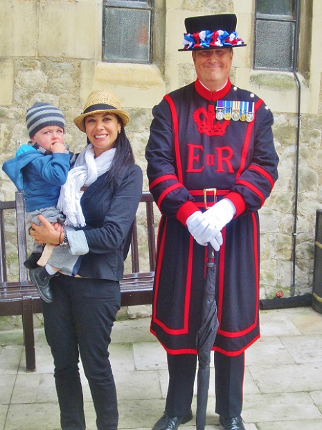 Mel B standing with a Yeoman warder