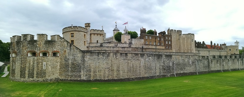 Outside view of Tower of London including grassed moat
