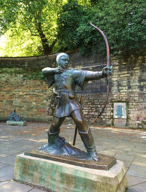 Bronze statue firing an arrow