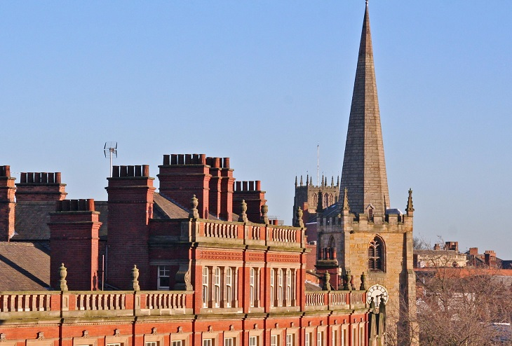 Red brick chimneys and church spire