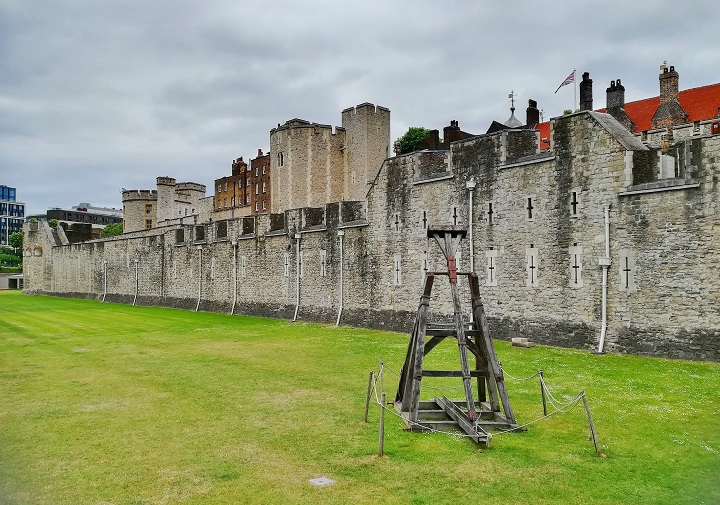 Trebuchet on display on the grass covered moat.