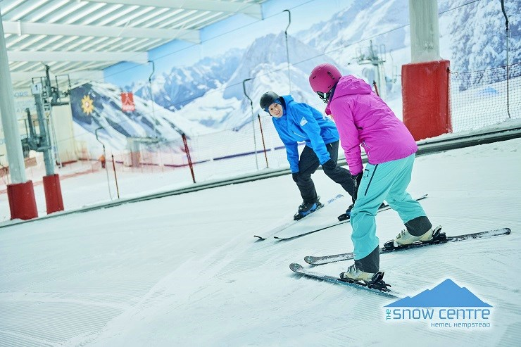 Ski Instructor with a pupil on the indoor slope