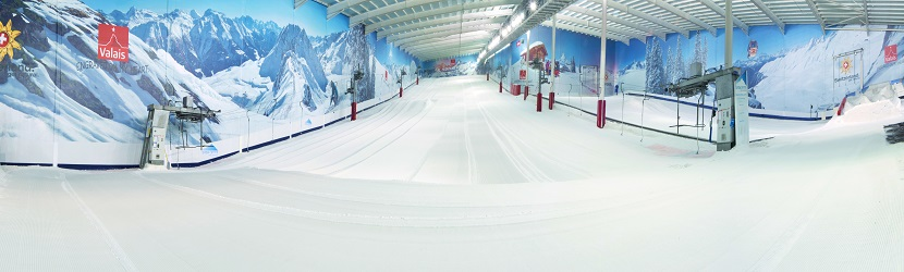 The two freshly groomed indoor ski slopes