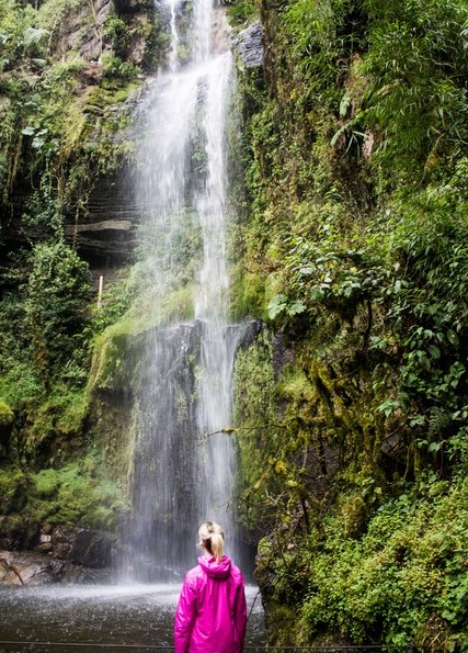 Hiker admiring the waterfall