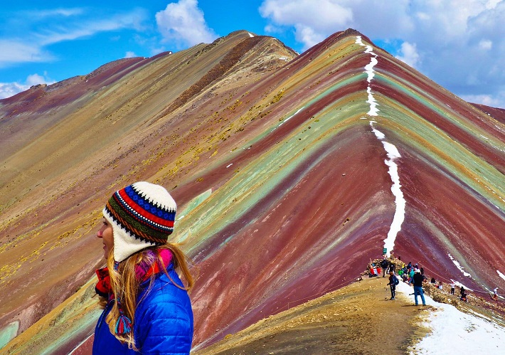 Hikers on the ridge of the multi-coloured mountain