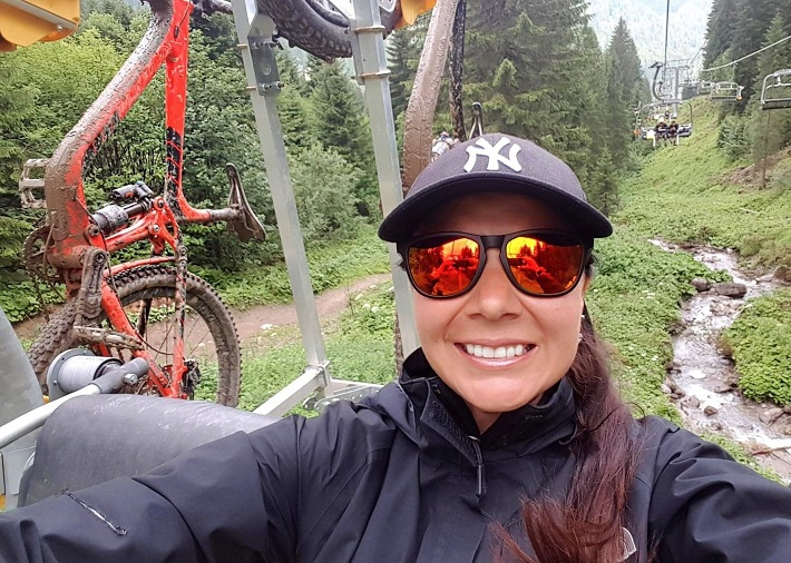 Selfie on the chairlift with mountain bike hanging on the back