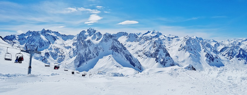 Panoramic view of chairlift and French Pyrenees in Grand Tourmalet ski resort