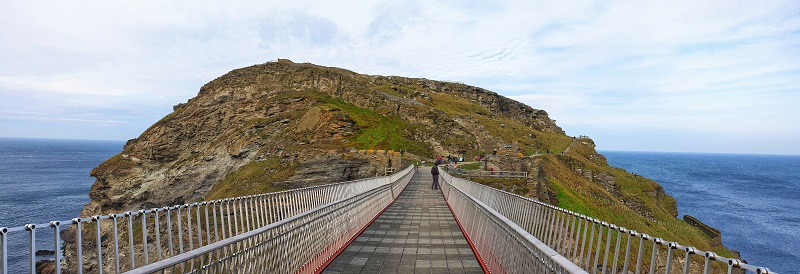 Crossing the footbridge one of the tops things to do at Tintagel Castle