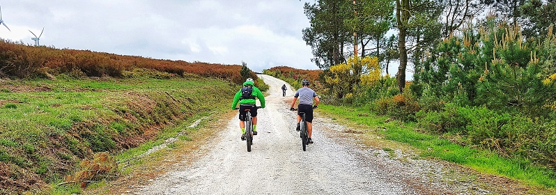 Mountain bike riding high up the hills in Galicia Spain